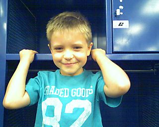 Caiden in a locker of the Visitors Locker Room.