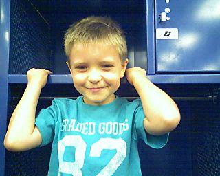 Caiden in a locker of the Visitors Locker Room.